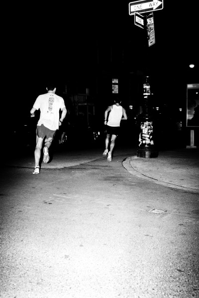 Two OSR runners in traffic during the 2013 Midnight Half (6/28/13) shot by David J. Oh